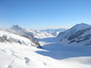 Alpské ľadovce - Alpské ľadovce v okolí Jungfraujoch. Pohľad z výšky 3571 m.n.m. kde sa nachádza stanica vlaku ako aj meteorologická stanica.
